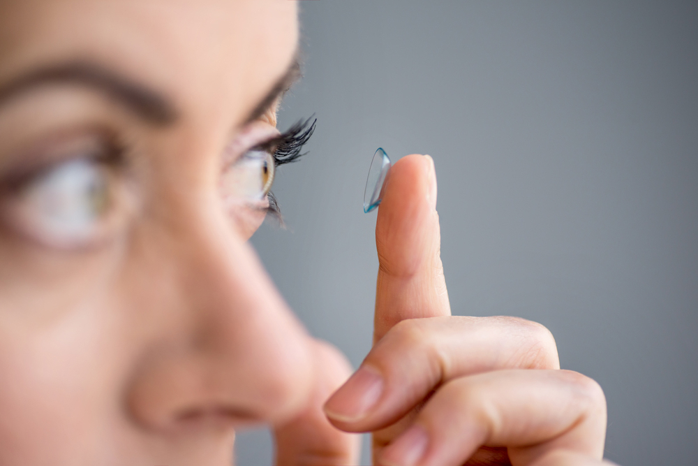 woman putting in a contact lens