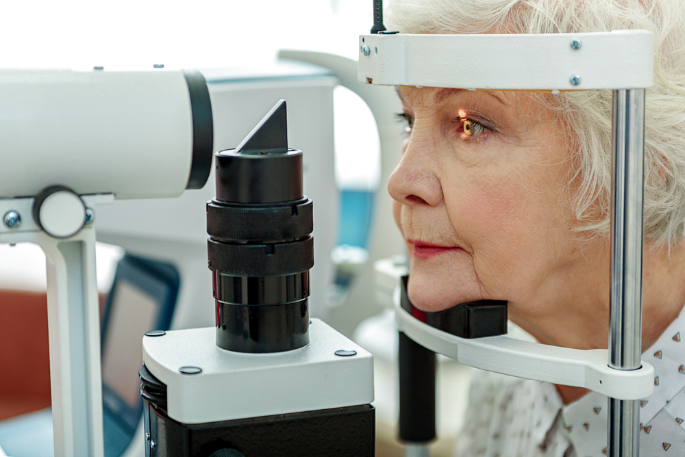 woman receiving an eye exam for diabetes